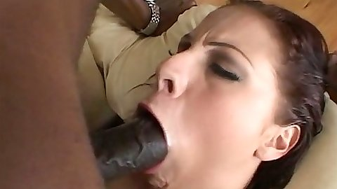 Gianna Michaels receives a fat black cock in her mouth and cowgirl cock ride