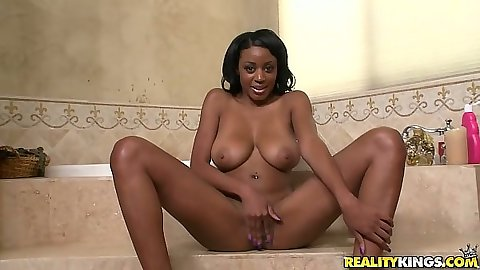 Chelsea sitting on the tub naked all wet with legs spread in shower