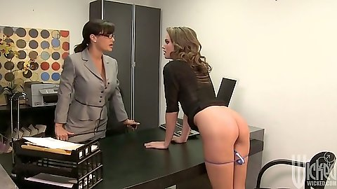 Tori Black and Lisa Ann are two milfs in the office getting naughty on desk