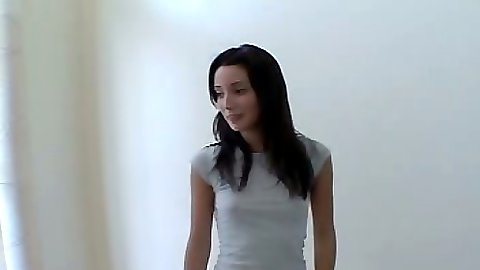 Brunette 18 year old Chloe18 rolling up her skirt and sitting on floor