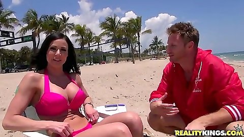 Public milf in a bikini on a beach outdoors getting  tan
