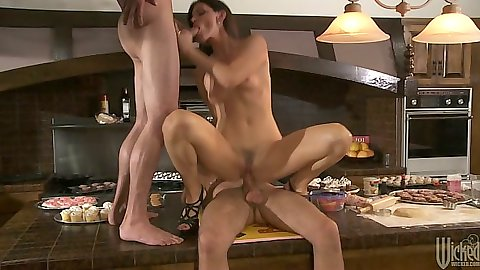 India Summer sits on mans dick in threesome sex on table