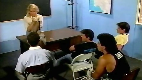 Debi Diamond teaching a class and getting student cock in her mouth