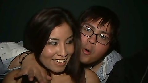 Asian Jessica Jammer at a party having drinks and needing attention