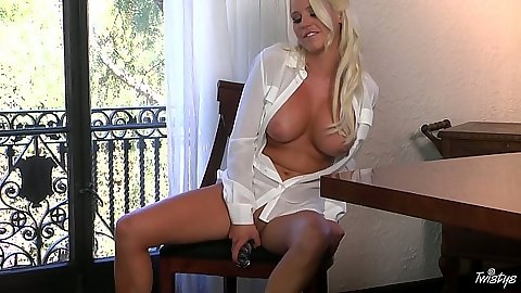 Spencer Scott wearing a white shirt on her naked body with dildo