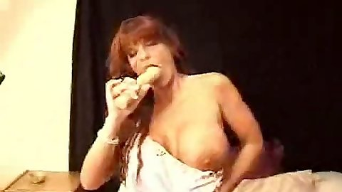 Milf redhead with big tits fucking her pussy and ass with dildo