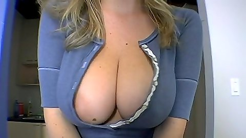 Big tits Sara Stone ripps her shirt open and eats and sandwich