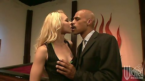 Blonde Melanie Jayne undressing and sucking huge cock head from man in suit