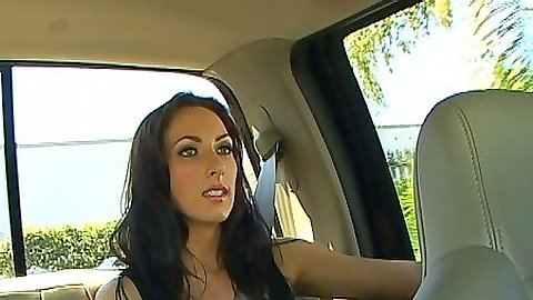 Brunette taking a drive in the backseat