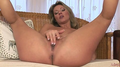 Busty Carolyn Cage spreading legs and touching shaved pussy
