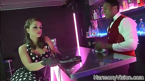 Liza Del Sierra sitting at the bar doing to the barmen and eatne out
