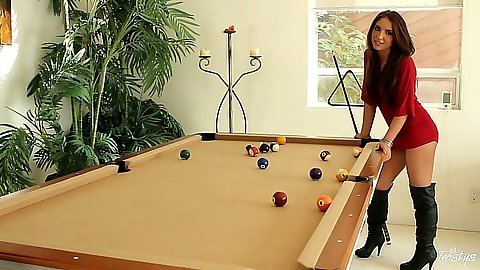 Brunette Giselle Leon playing some pool in a short dress