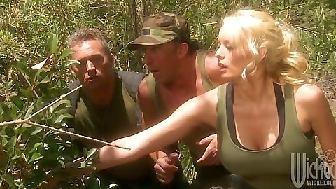 Big tits Stormy Daniels in military camp with big dicks drinking