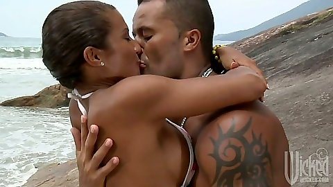 Beach making out with Claudia Bella sucking cock by the water