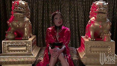 Asian Kaylani Lei sitting sexy