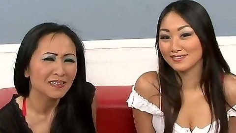 Asian girls Kitty and Evelyn lift their skirts