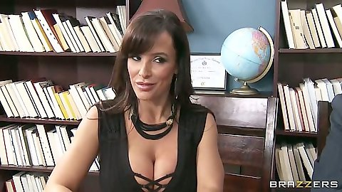 Lisa Ann office milf goes down on guy