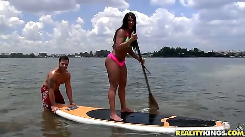 Surfing up in bikini with Leticia outdoors