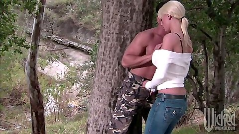 Blonde Tanya James makes out in the forest outdoors