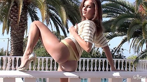 Posing solo outdoors Lauryn May fingering pussy