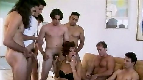 Classic group gang bang with Deborah Wells filled with cock