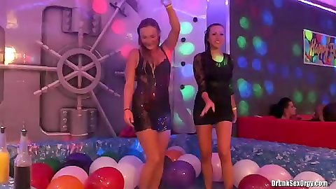 Wetlook babes in soap bath at club