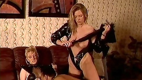 Sahara Sands in group fetish scene with spanking