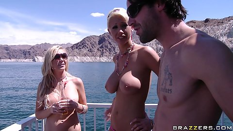 Two topless babes with big tits on a yacht on sunny day