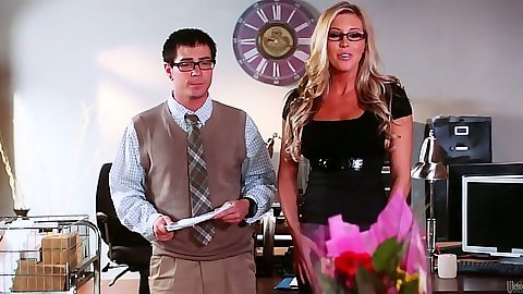 Blonde Ash Hollywood puts a gag on a male for fetish action