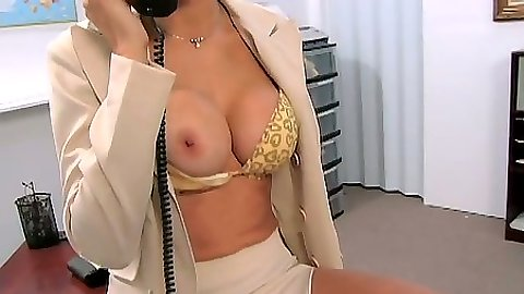 Big tits milf Monique Fuentes rolling around the office table in miniskirt