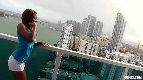 Latina Gulliana Alexis posing sex in shorts and sucking dick on the balcony