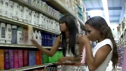 Ebony lesbians Tina and Capri go shopping in public