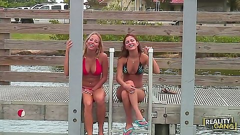 Bikini outdoor babes Ashley Jensen and Nicole Grey go on a boat