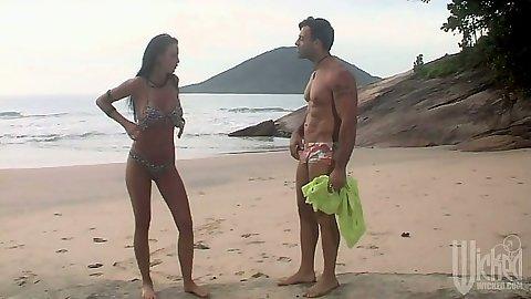Bikini beach girl teen Karine Muller goes down to suck dick outdoors