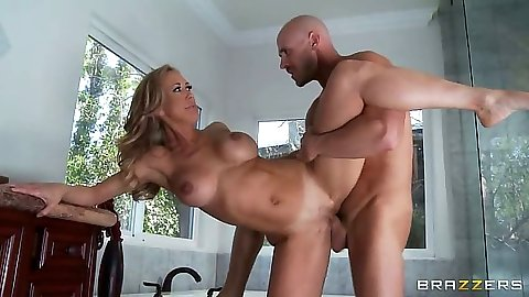 Standing fuck milf Brandi Love goes for a titty fuck on the kitchen