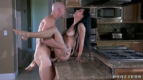 Busty latina Isis Love gets some cock on the kitchen teable