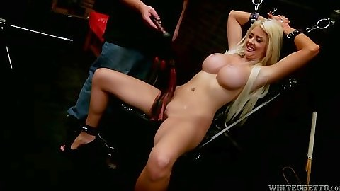 Bondaged up blonde Courtney Taylor in fetish maledom