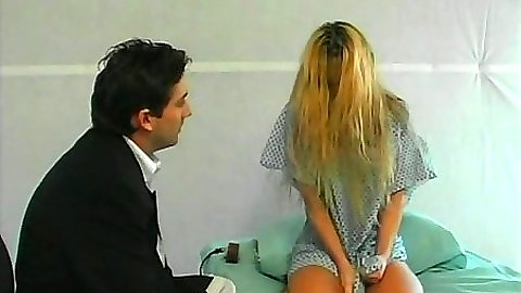Undressing blonde Nina Ferrari on hospital bed