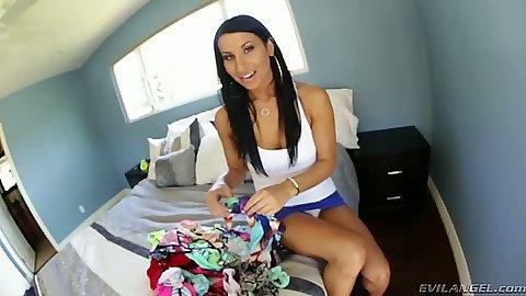 Brunette fully clothed Sophia Bella rolls up her skirt