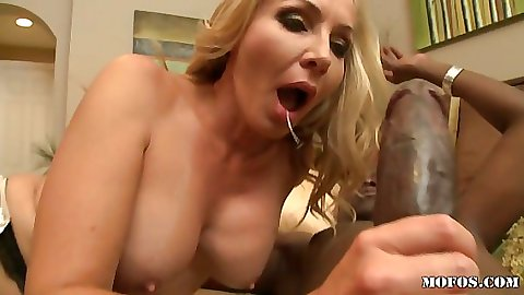 Sexy milf with big tits moans a bit while riding black cock