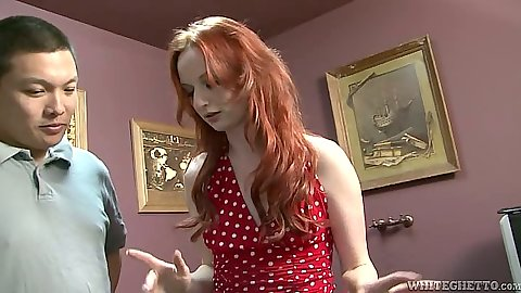 Redhead Audrey Lords fully clothed in a miniskirt