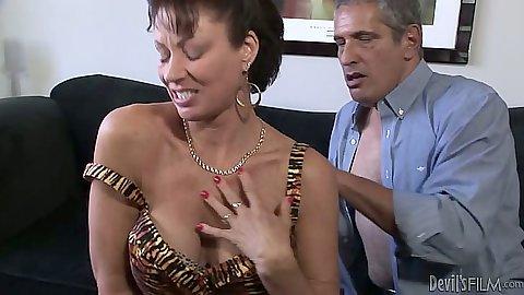 Undressing milf Vanessa Videl moves down to suck mans penis