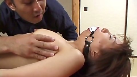 Fetish with asian slut wearing a mouth gag and hairy pussy fingered