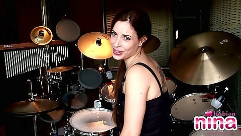 Brunette Nina showing her ass in panties solo by the drums set