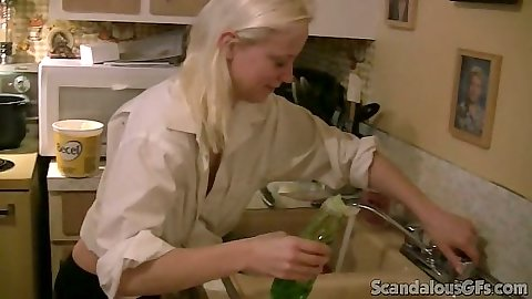 Blonde gf Jewel cooking something up in kitchen on home video