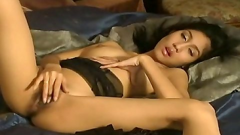 Asian in lingerie and exposed nipples fucking her hairy hole with a dildo