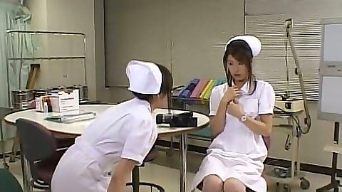 Horny asian nurses touching each other in hospital