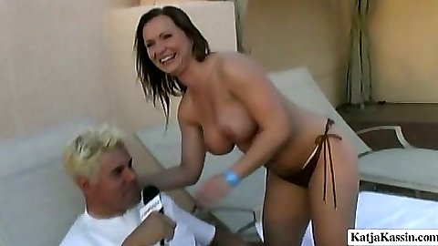 Big tits outdoor interview with Katja sitting on dressed dude