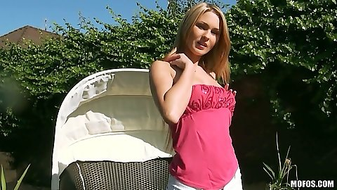 Antonya solo posing outdoors and using a badminton racket on her pussy