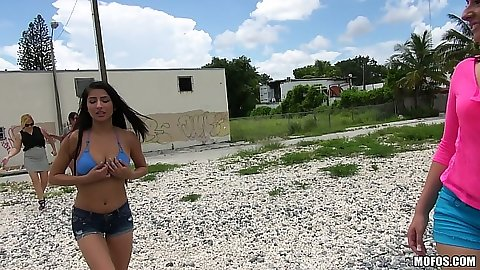 Outdoor chicks flashing their bare tits on the road with Nikki Lavay and Megan Salinas